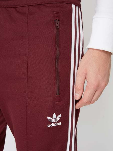 sneakers picked up in stock ADIDAS Originals – Trainingshose mit Logo-Streifen – Bordeaux Rot