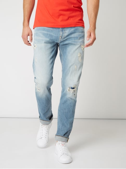 5c1f5e66e8fb ... Calvin Klein Jeans Destroyed Tapered Fit 5-Pocket-Jeans Hellblau  meliert - 1