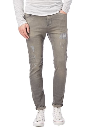 REVIEW Skinny Fit Jeans im Destroyed Look Stein - 1