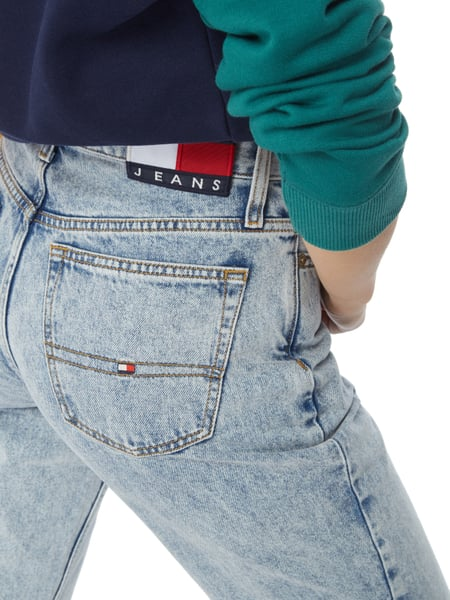 Mom Jeans We love the rigid fabrication of mom jeans for a fun, '90s feel. They come in several colors with a tapered hem that can be worn rolled or unrolled, and sit cinched at the small of your waist.